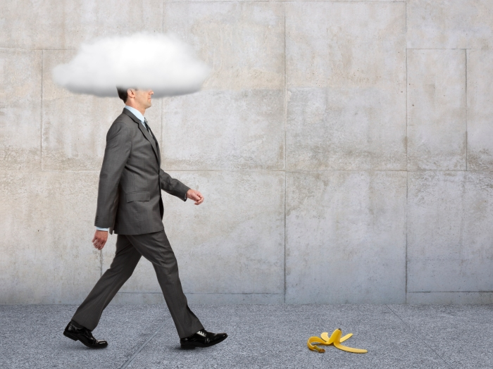 Businessman With Head In Clouds With Banana Peel In Path